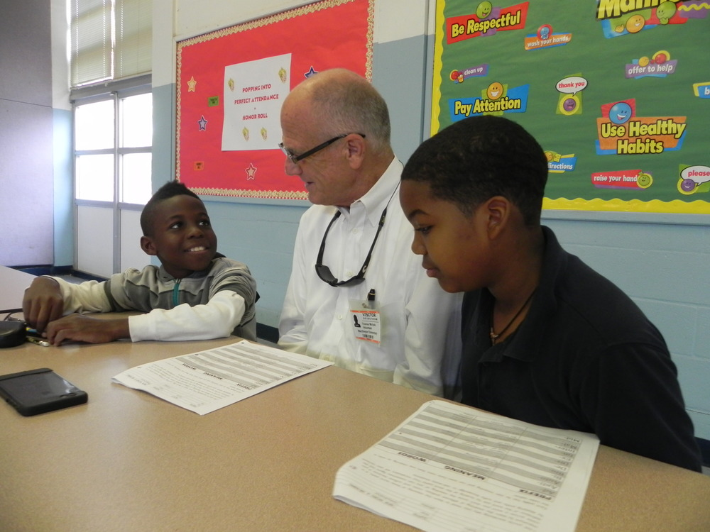 St. Paul's member Tom Michalk tutors two MacGregor Elementary School children