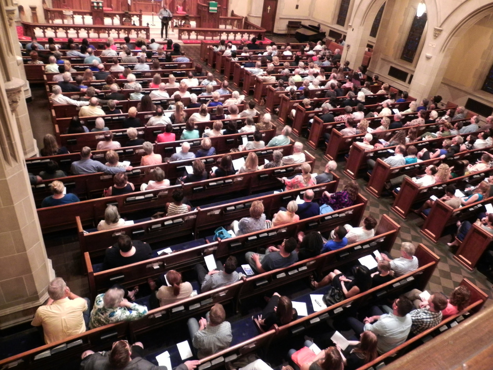 Around 400 people gathered for a vigil led by St. Johns' UMC and hosted by St. Paul's UMC