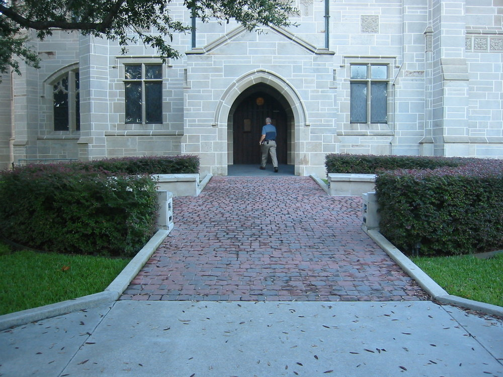 The main entrance has too steep of an incline and an improper landing to be fully accessible.