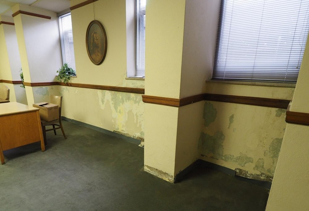 Water infiltration in the basement has created damage in classrooms and offices.