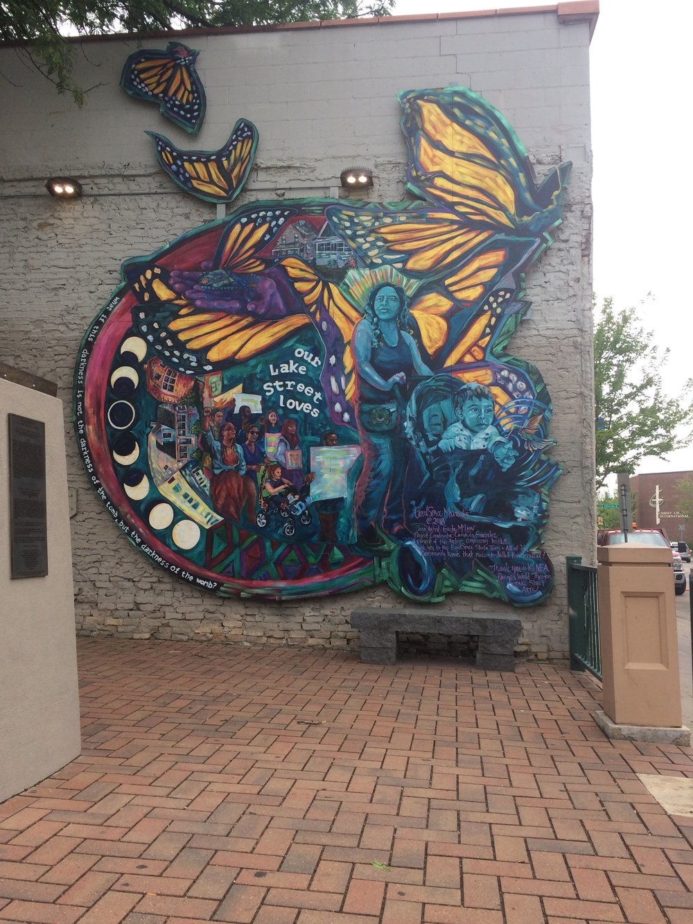 a mural in the South Minneapolis neighborhood that has the much loved monarch butterfly, a symbol of immigration as it annually travels from Canada down to Mexico.