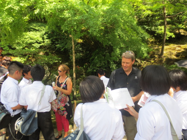 Japanese students learning English interviewed us in the temple garden