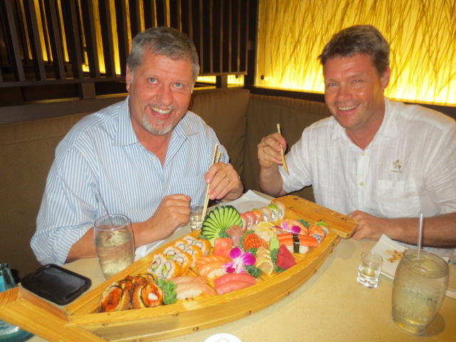 Benni and Valdi digging into a sushi boat