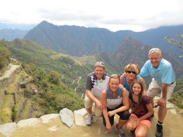 The team with Machu Picchu in the back ground