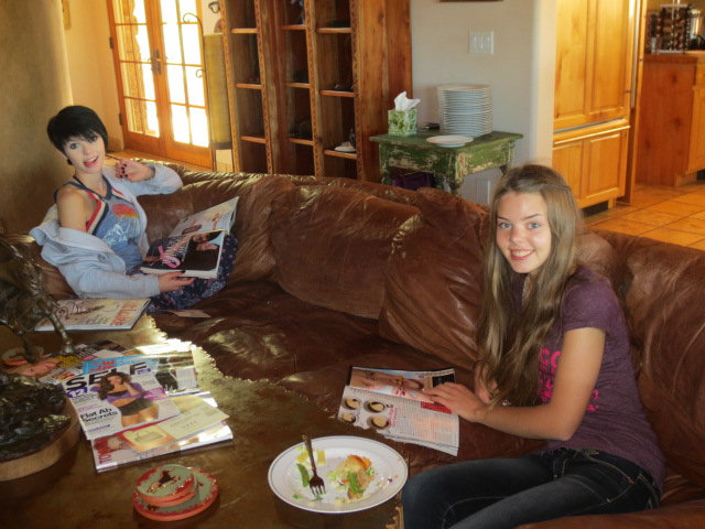 Sophia and Dora enjoying lunch and some glossy magazine time.