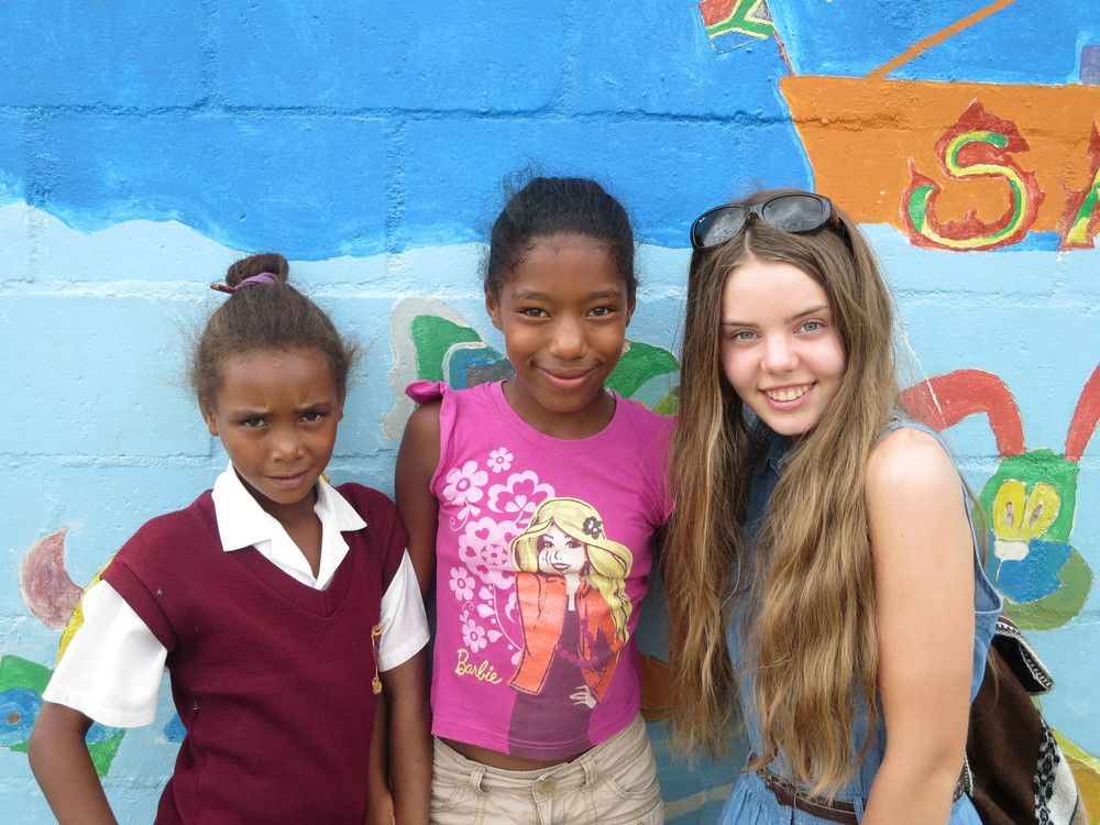 These girls came to the kindergarten after school and they were eager to have their photo taken