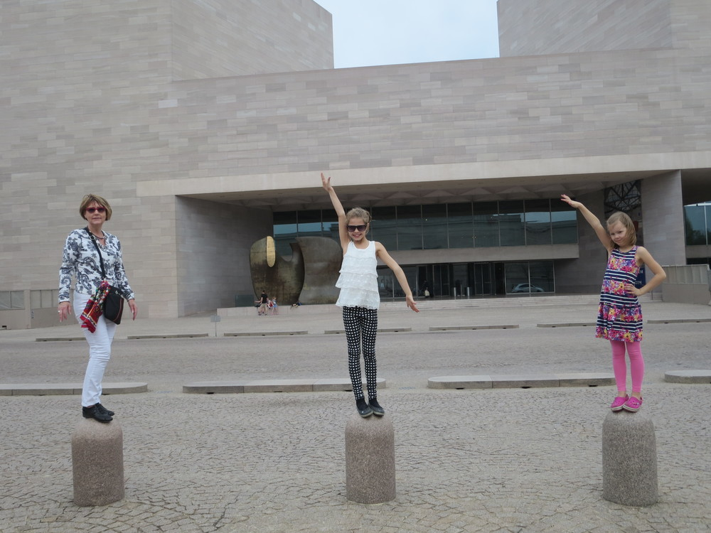 The girls had to try to out-do the boys. In front of the Modern Art Museum that was closed for the time being