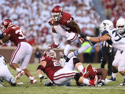 Brennan Clay vaulted OU over the top against the Mountaineers. (Photo courtesy: usatoday.com)