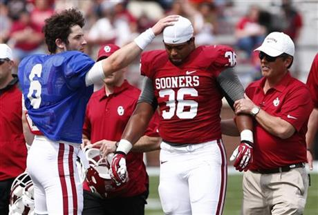 Dmitri Flowers' injury was one of the few buzzkills on an otherwise good day for the Sooners. (Photo courtesy: bigstory.ap.org)