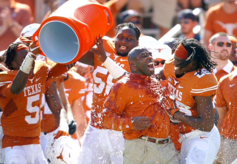 If Texas beats Notre Dame this year, Charlie Strong should expect another postgame dousing.