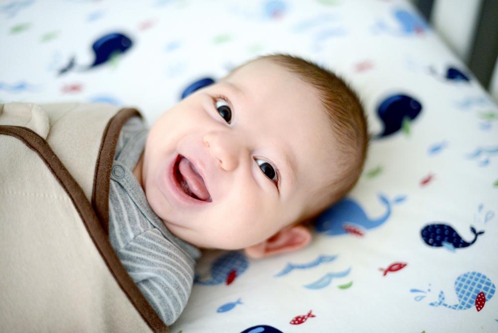 DSC_1978 owen big smile in crib.jpg