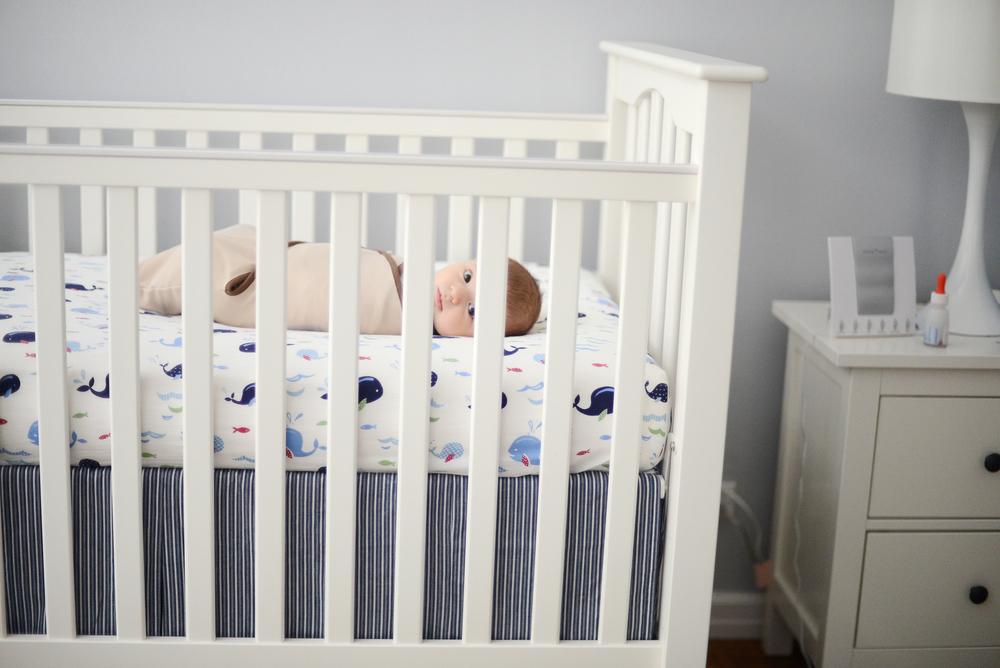 DSC_1968 owen wrapped in crib.jpg