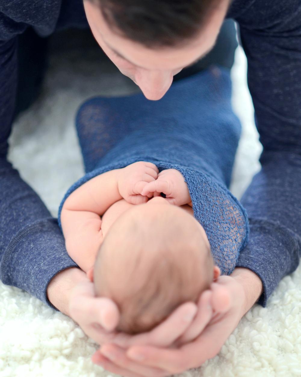 DSC_0012 rich cradle owen head in hands color.jpg