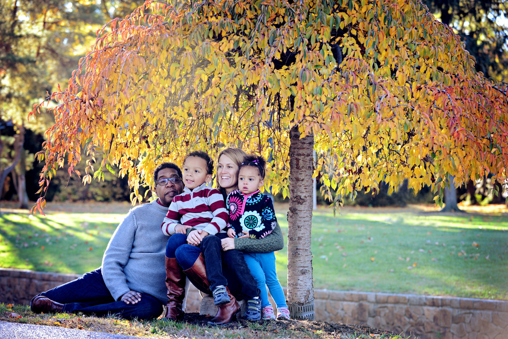 DSC_9175 family under tree umbrella color.jpg