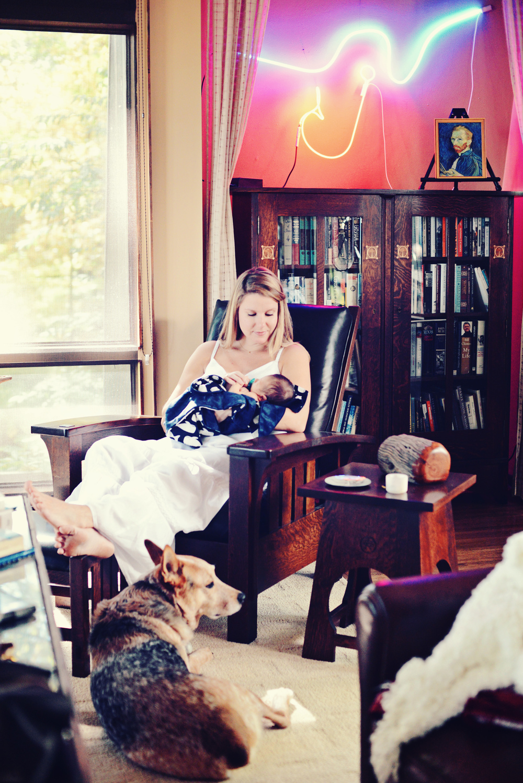 DSC_3626 shawna sit in chair neon light.jpg