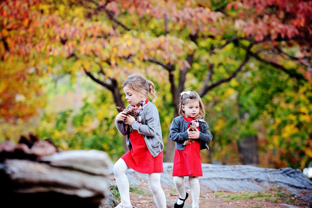 DSC_4438 girls carry pinecones.jpg