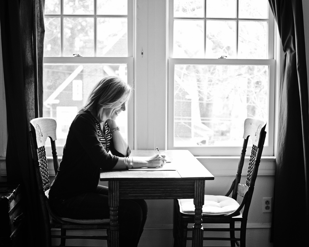DSC_0615 tracey writing by window B&W.jpg