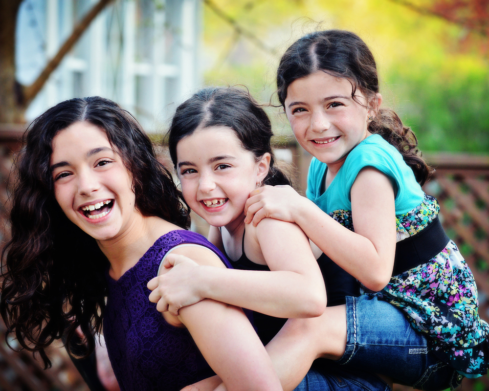 DSC_8092 3 girls piggy back big laugh 8x6 for website.jpg