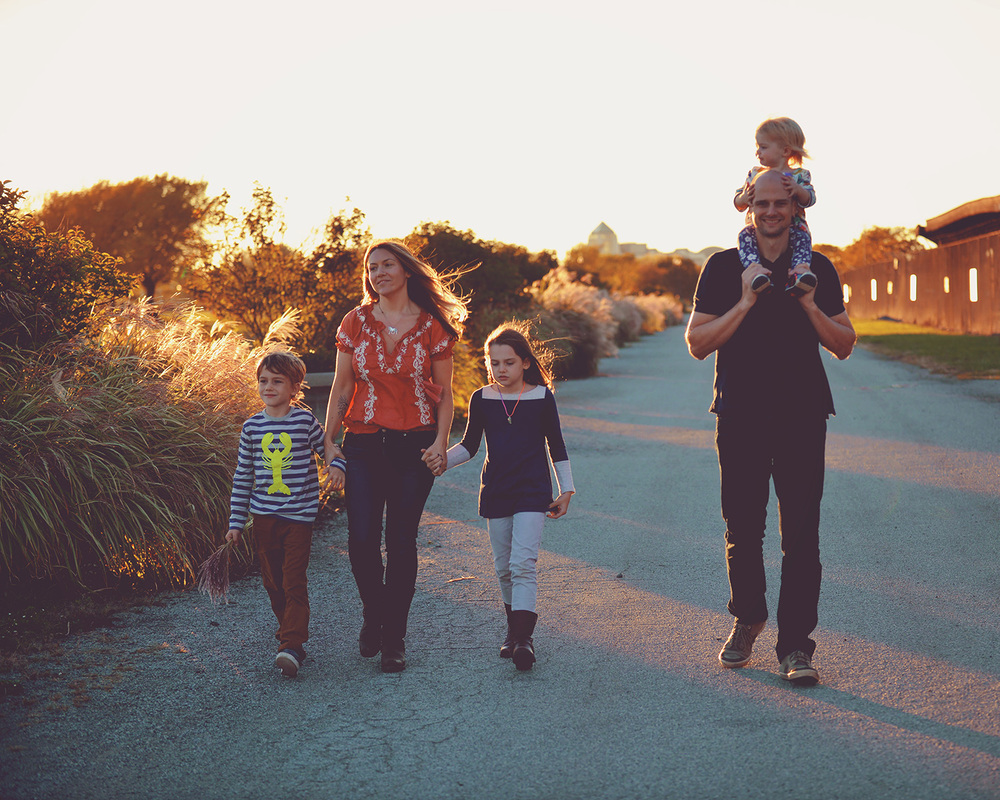 DSC_1214 family walking in golden sun web gallery.jpg