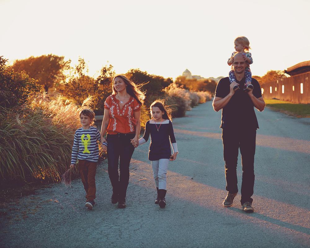 DSC_1214 family walking in golden sun web gallery.jpg