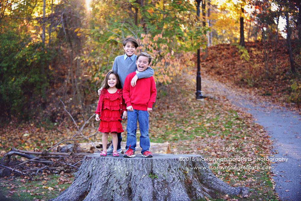 DSC_1598. three kids laugh on stumpjpg wm.jpg
