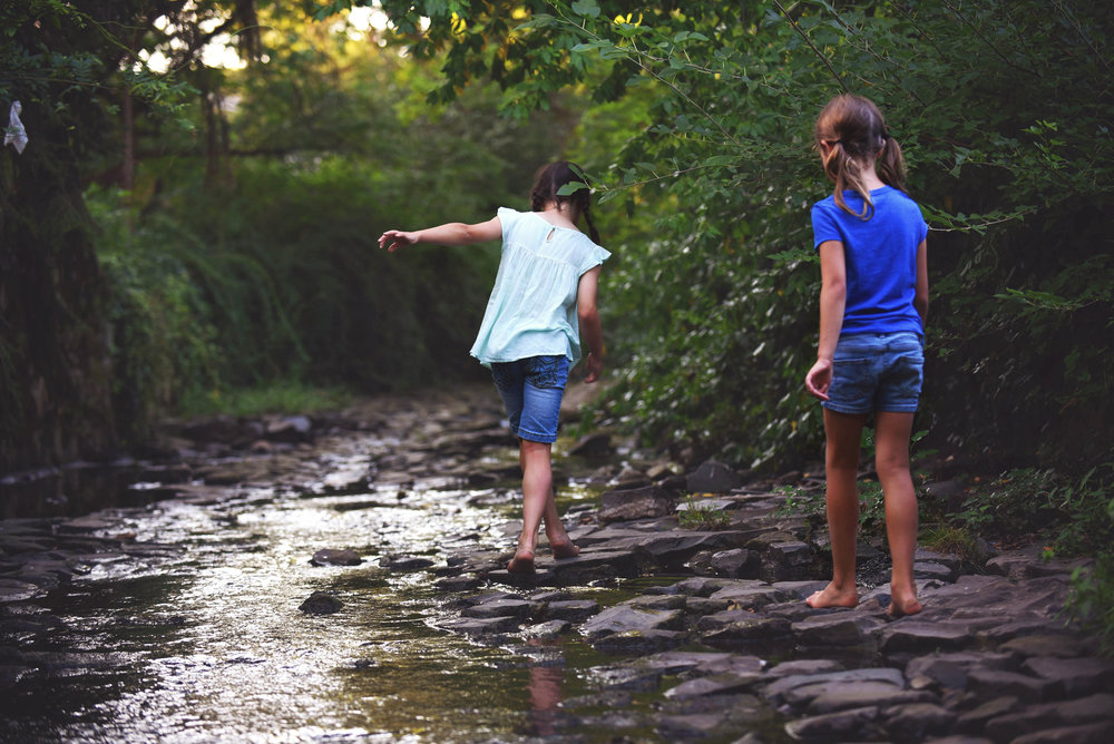 DSC_5139 girls walking in creek.jpg