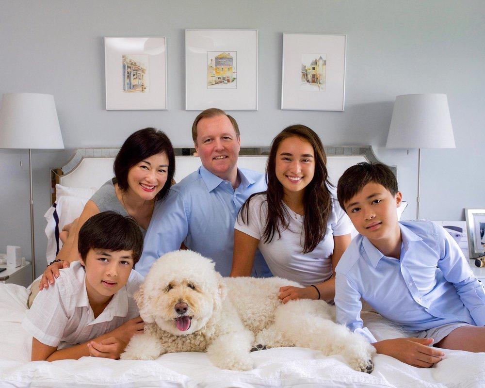 DSC_6595 family together on bed FINAL web.jpg