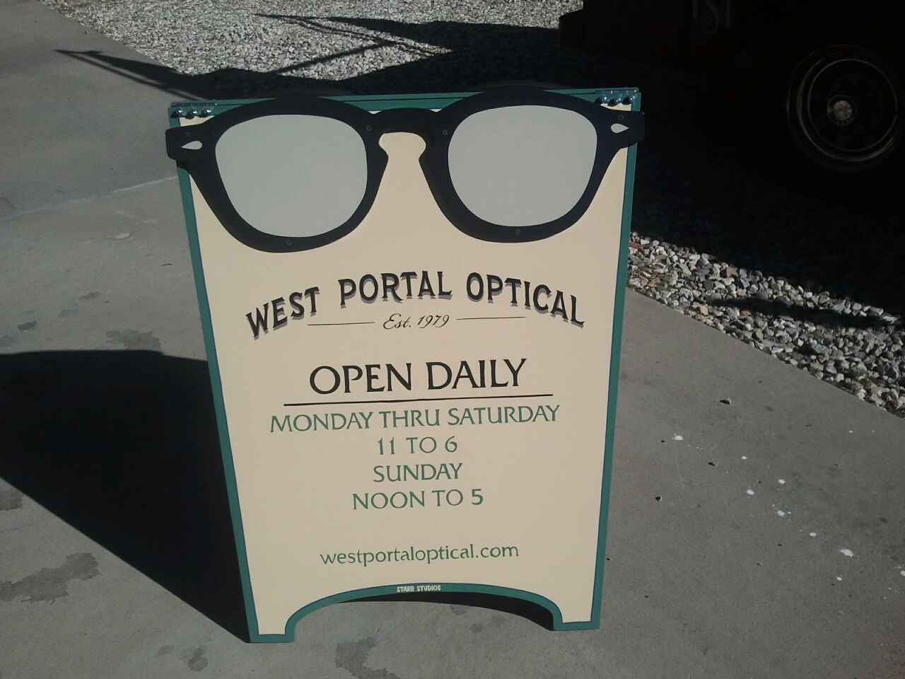 Hand painted sandwich board sign we made for an optometrist