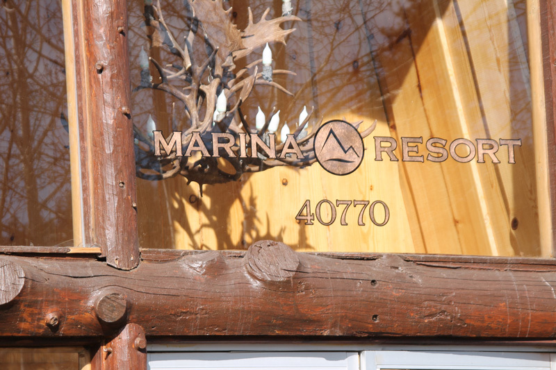 Copper Leaf Window for Marina Resort. All hand painted reverse glass gilding with genuine copper leaf.