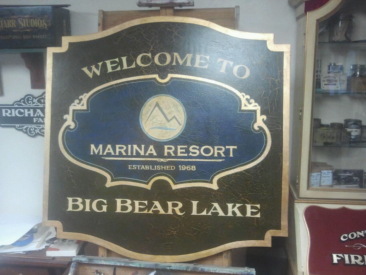 Antiqued gold leaf sign we just finished yesterday for Marina Resort in Big Bear Lake, California. This is going in their lobby above the reception desk.