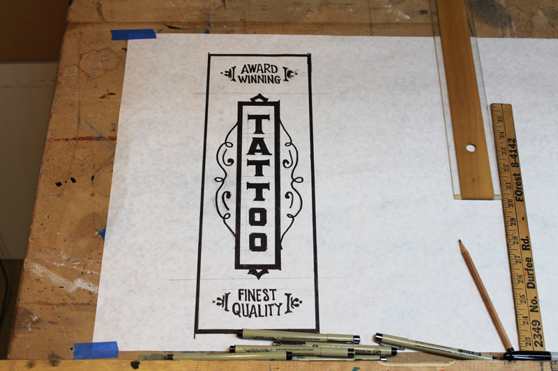 Preliminary wall sign sketch for Stainless Studios Tattoo in Dallas