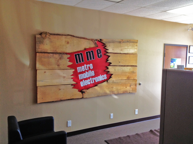 Sign for Metro Mobile. We had a lot of fun with the layers in this sign. Hand painted on wood; distressed.