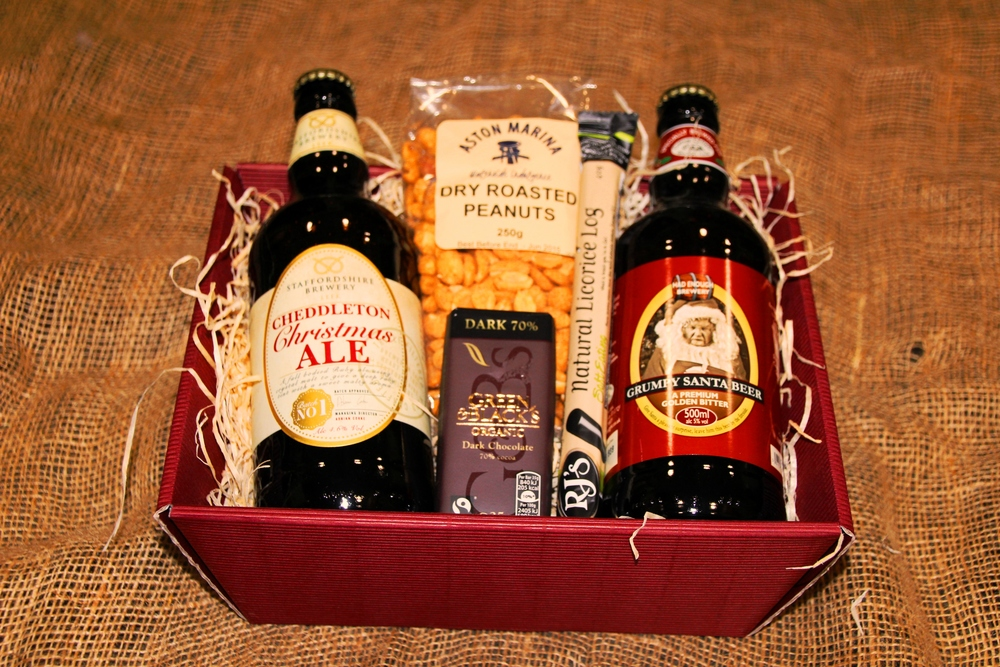 The Sandon Hamper includes: - two local ales, RJ Liquorice log, organic dark chocolate, dry roasted peanuts, gift basket, wood wool, gift wrapping, ribbon & bow