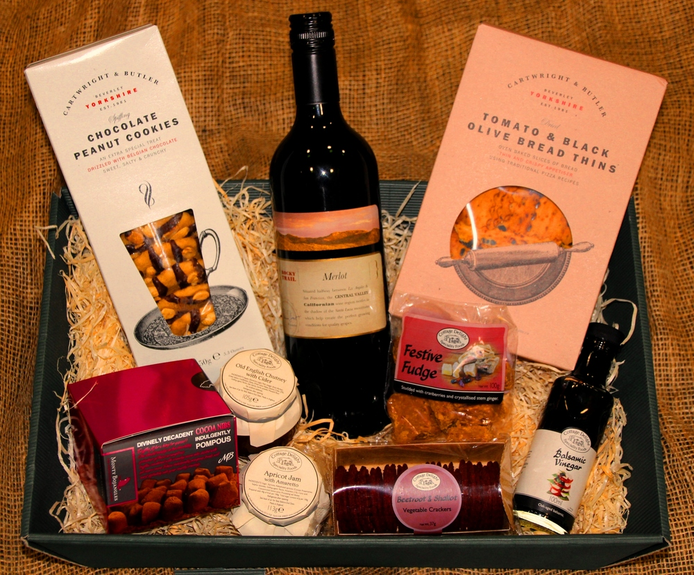 The Eccleshall Hamper incudes: - 75cl Merlot or Chardonnay, chocolate & peanut cookies, festive fudge, tomato & black olive thins, artisan balsamic vinegar, beetroot & shallot crackers, chocolate truffles, apricot & Amareto jam, Old English chutney, gift basket, wood wool, gift wrapping, ribbon & bow
