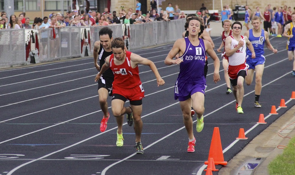 Andrew Baker Winning the 800 Meter run at the section track meet.