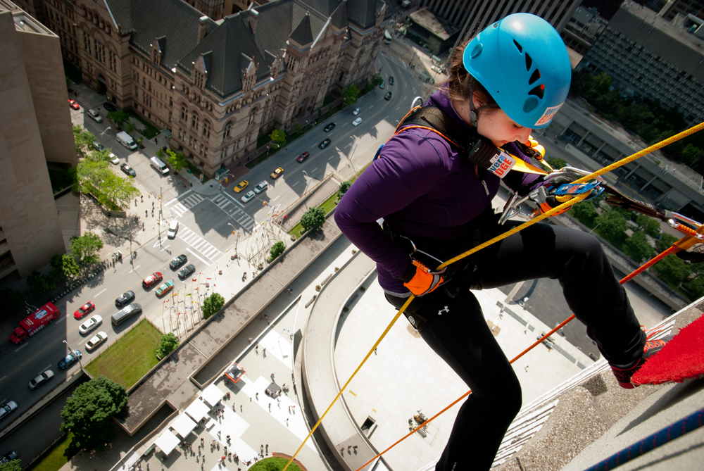 Here is Kayla rappelling down City Hall at the Rope for Hope event last year! Who will rappel down this year?