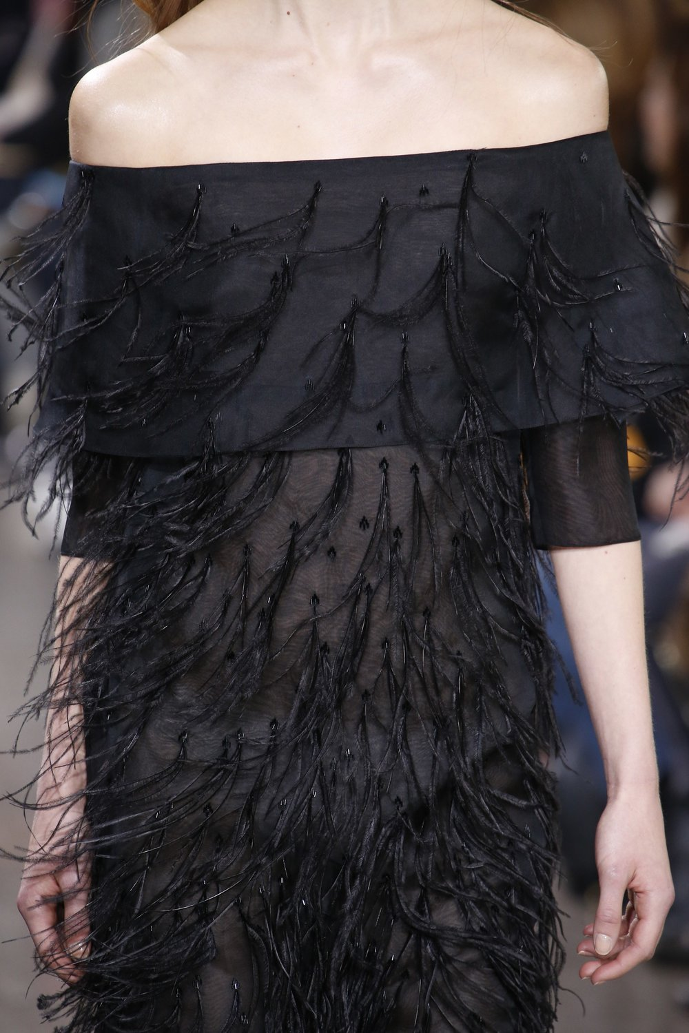 It's all in the details for Jason Wu's collection. Captured from the front row, Wu's hand sewn evening gown is embroidered with dainty feathers that flow with the movement of the garment.