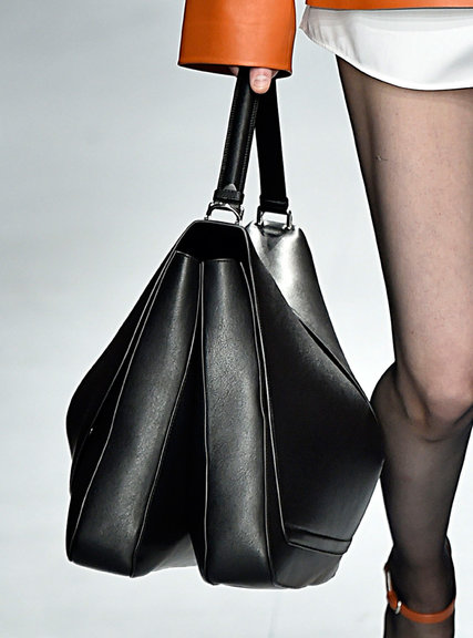 Small bags seem to be all the rage this season, however who can resist a bag that can fit an all in one! Jill Sander really went for an exaggerated look with her larger shoulder bag, displayed in a few differentiated seasonal colors for the fall.