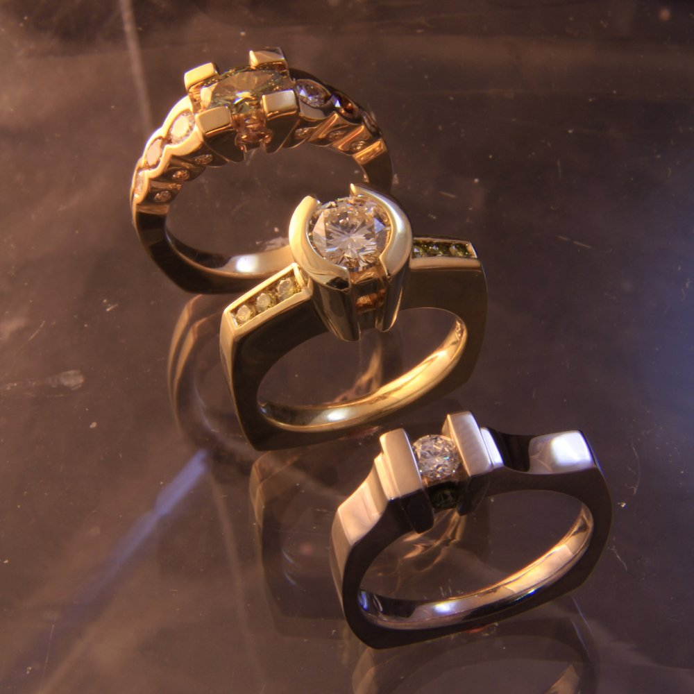 Diamond rings by Art Metals Studio.