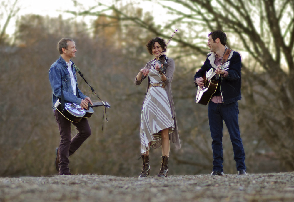 Will Straughan on dobro and guitar, Natalya Zoe Weinstein on fiddle, and John Cloyd Miller on mandolin and guitar
