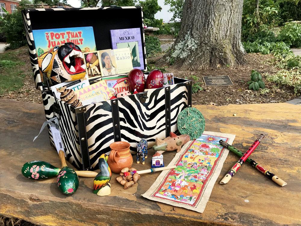 Latin American Culture Kit | B ooks, posters, maracas, artwork, Aztec calendar stones, artifacts, textiles, and more.