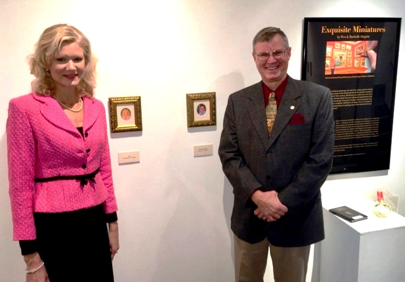 Rachelle and Wes Siegrist posed with their miniature self portraits at the HMA exhibit January 20 - March 17, 2019.