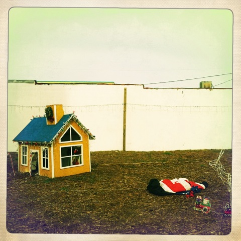 Christmas Eve, Carolina Beach, NC   This has to be one of my favorite xmas images of all time. From an already decaying Xmas village on Christmas Eve… right off the beach.