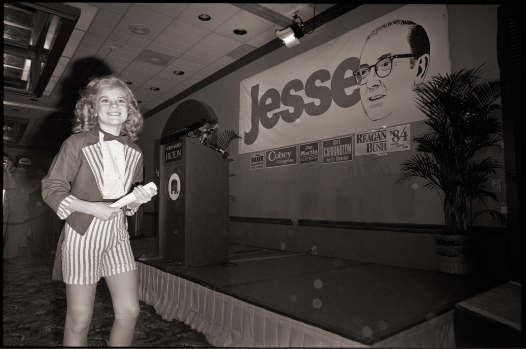 1984 Election Night: Helms vs. Hunt.    At the time this was the most expensive gubernatorial race ever run. Mudslinging wasn't in short supply either. Both men were extremely popular in North Carolina and I thought this might be the year that Jesse Helms was finally unseated.    The young lady in the photo performed later that night, singing a song she had written in honor of Helms and Reagan. Helms won that night.