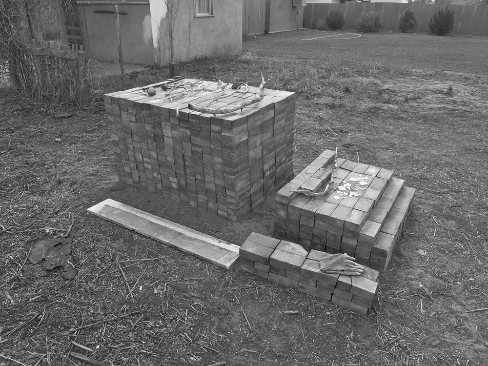 28-31 January 2014: Lynn and Rebecca managed to dig up these bricks with their hands, brushing them clean with leather gloves. All sorts of glass/remnants of glassware lay buried here, we think, used to be a pharmacy or mechanics shop. We stacked the bricks in fourteen rows, Josh made the joke, it is a brick sonnet, or an ode to Carl Andre.
