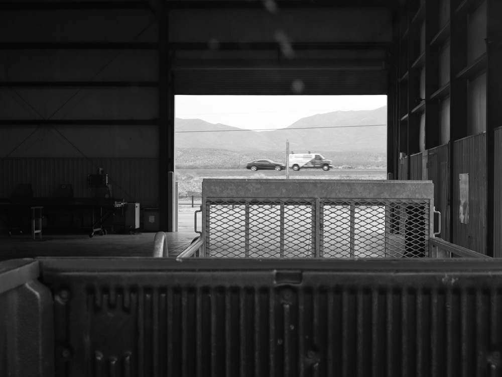9 January 2015: Josh and I went to El Paso to pick up our Mueller U-Panel roofing material (26-gauge commercial grade steel, in white, for maximum reflectivity). This is a view from the loading station: truck-bed, trailer-hitch, and open road (2mi from New Mexico).