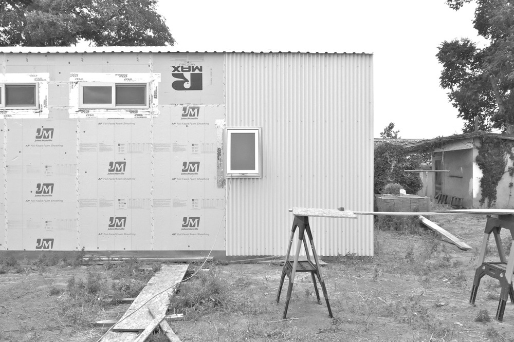 21 May 2015: Three panels of siding on the north wall.