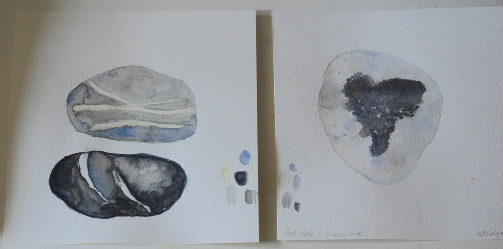 Small and larger unframed watercolor sketches of stones and shells