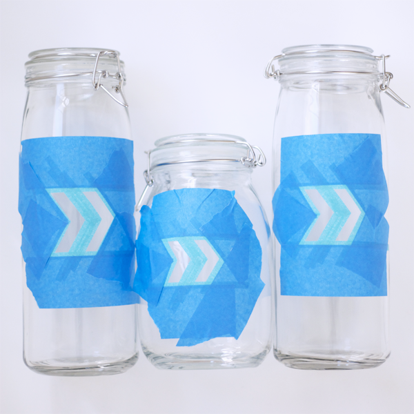 Using patterning tape create arrow patterns. Use blue painter's tape to cover areas around pattern.