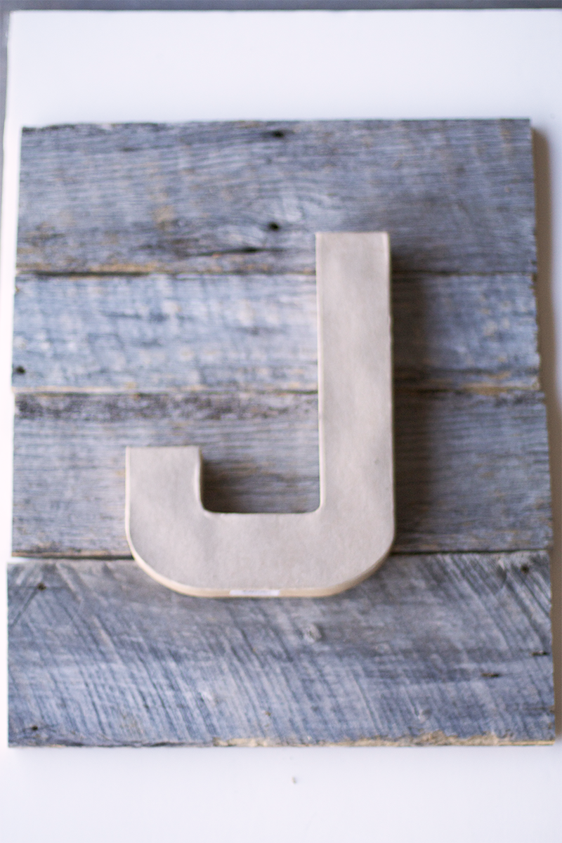 Hammer a nail in the wood where the hole in the letter will fit over. Note for some of the letters like the J you will need to put another hole at the top of the J curve so it hangs straight. Hang letters and hang signs!
